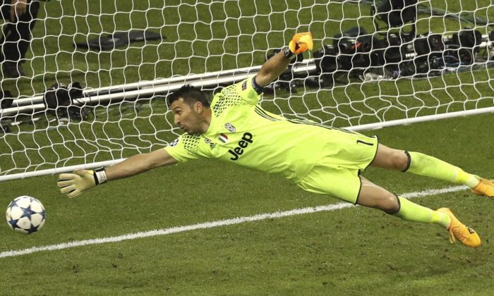 Juventus goalkeeper Gianluigi Buffon is beaten by Real Madrid's Casemiro scoring his side's 2nd goal during the Champions League Final soccer match between Juventus and Real Madrid at the Millennium Stadium in Cardiff, Wales, Saturday, June 3, 2017. (AP Photo/Alastair Grant)