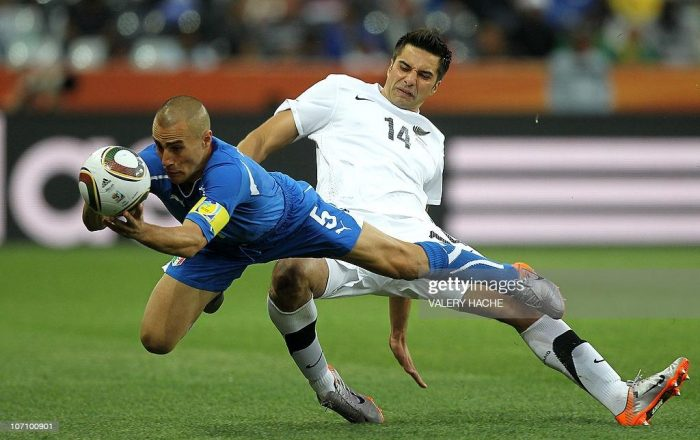 Italy's defender Fabio Cannavaro (L) catches the ball after being tackled by New Zealand's striker Rory Fallon during the Group F first round 2010 World Cup football match Italy vs. New Zealand on June 20, 2010 at Mbombela Stadium in Nelspruit. NO PUSH TO MOBILE / MOBILE USE SOLELY WITHIN EDITORIAL ARTICLE  -           AFP PHOTO / VALERY HACHE (Photo credit should read VALERY HACHE/AFP via Getty Images)